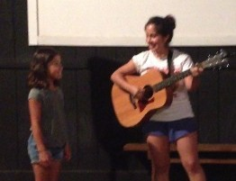Isa and Nora performing in the talent show