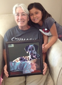 Mom and Isa posing with a painting done by my friend, Melani Guinn.