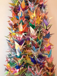 Paper origami cranes in a local church created to honor the many lives lost in mass shootings.